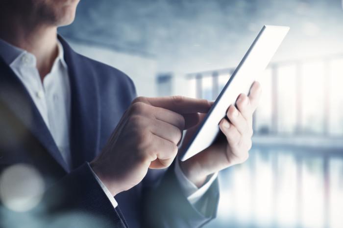 Realtor reading a tablet
